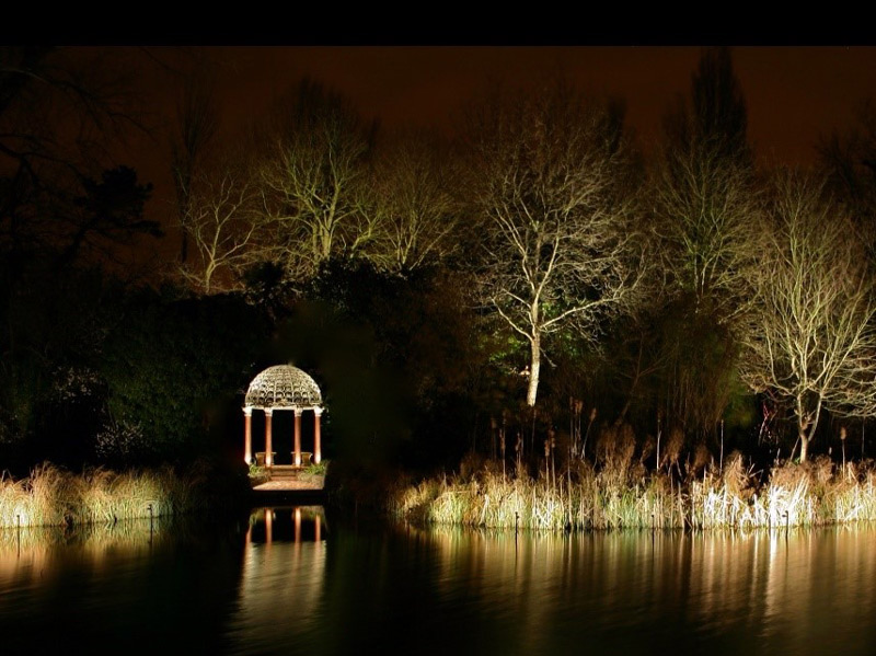 beautiful lakeside gazebo with garden lighting for evening