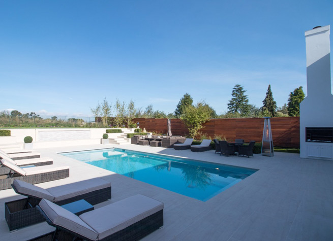 swimming pool with white porcelain paving